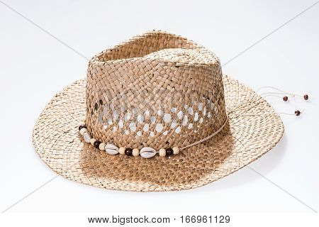 Straw hat isolated on white background. Brown straw hat isolated