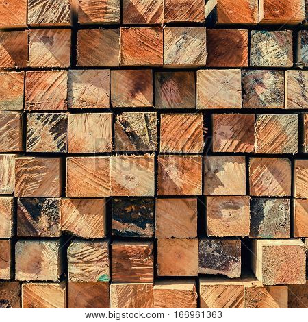stack of lumber in timber logs storage for construction texture background