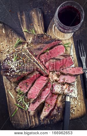 Barbecue Wagyu T-Bone Steak sliced on Cutting Board