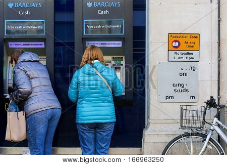 Cornmarket Street Oxford United Kingdom January 22 2017: Customers using a Barclays Bank ATM Bancomats Free Cash Withdrawals at the branch on Cornmarket Street Oxford city centre England