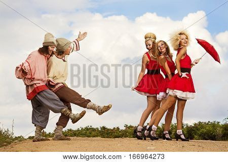 Two old-fashioned Russian boys flirt with three Americans retro girls.