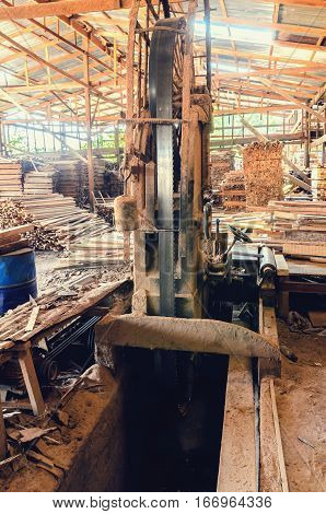 industrial wood production factory band saw sawmill being used to cut into dimension lumber