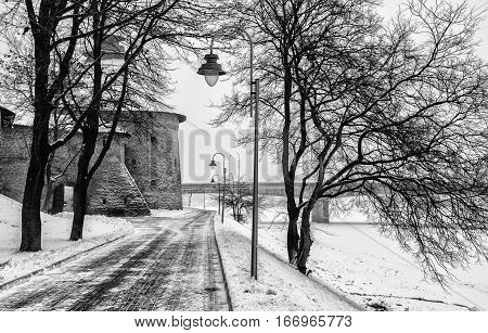 Pskov intercession tower in the background the snow-covered embankment