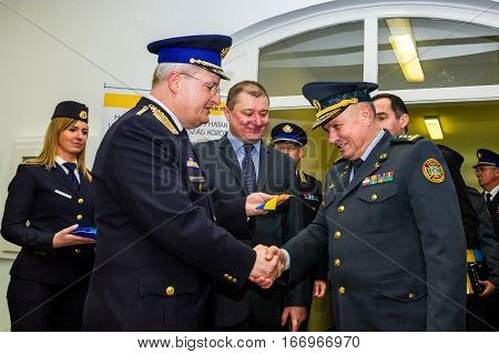 Záhony Hungary - January 25 2017: Head of the State Borderguard Service of Ukraine colonel general Viktor Nazarenko (R) and the deputy police chief - chief of law enforcement of Hungary major general Zsolt Halmosi (L) shake hands during the opening of the