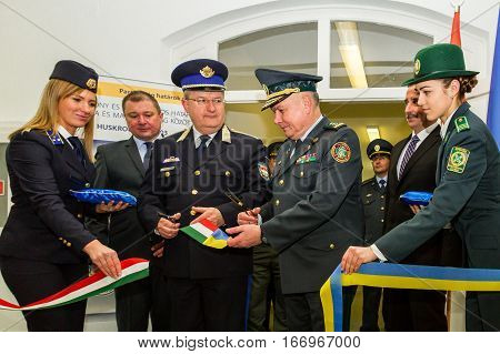 Záhony Hungary - January 25 2017: Head of the State Borderguard Service of Ukraine colonel general Viktor Nazarenko (R) and the deputy police chief - chief of law enforcement of Hungary major general Zsolt Halmosi (L) cut the ribbon at the opening of the