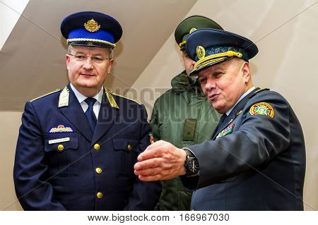 Záhony Hungary - January 25 2017: Head of the State Borderguard Service of Ukraine colonel general Viktor Nazarenko (R) and the deputy police chief - chief of law enforcement of Hungary major general Zsolt Halmosi (L) communicate during the opening of the