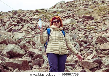 Woman are cleaning up a garbage in the mountains. Environmental protection. Tien Shan mountains Almaty Kazakhstan 2016