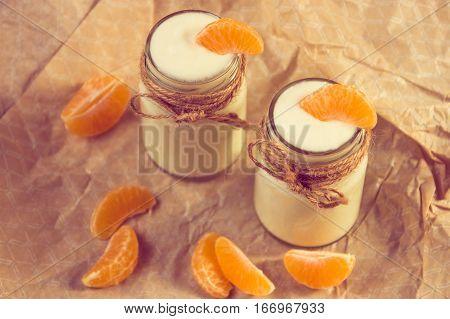 Organic Yougurt With Fresh Tangerine In Glass Jars