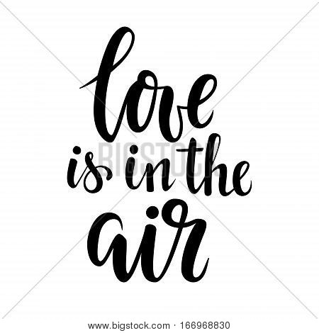 Love is in the air. Hand drawn calligraphy and brush pen lettering. design for holiday greeting card and invitation of the wedding Valentine's day and Happy love day.