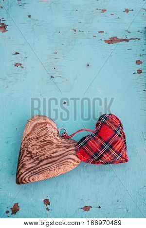 Linen and wooden heart on blue vintage background