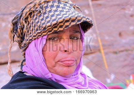 PETRA, JORDAN - NOVEMBER 17, 2010: Portrait of a bedouin woman with colorful dress