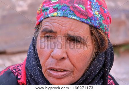 PETRA, JORDAN - NOVEMBER 17, 2010: Portrait of an old bedouin woman with colorful dress