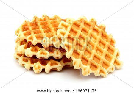 Round Belgian waffles isolated on white background.