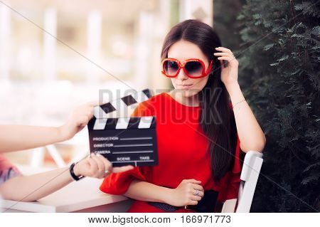 Actress with Oversized Shades Shooting Movie Scene