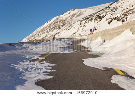 Mountain road covered with snow, closed for the circulation