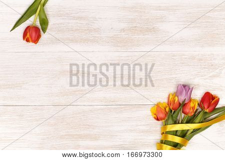 Lilac and red tulips in the white wooden table. Banner template layout mockup for Woman Day, Valentines Day and Teacher's Day. Photo for posts, blogs, advertising and news.