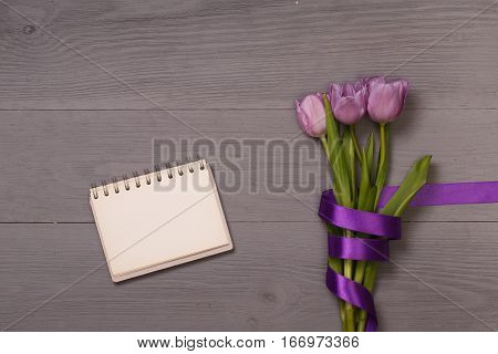 Lilac tulips and banner space for text in the lilac wooden table. Banner template layout mockup for Woman Day, Valentines Day and Teacher's Day. Photo for posts, blogs, advertising and news.