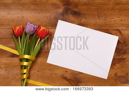 Lilac and red tulips and banner space for text in the  wooden table. Banner template layout mockup for Woman Day, Valentines Day and Teacher's Day. Photo for posts, blogs, advertising and news.