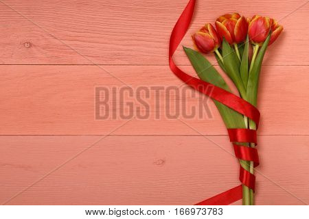 Red tulips in the lilac wooden table. Banner template layout mockup for Woman Day, Valentines Day and Teacher's Day. Photo for posts, blogs, advertising and news.