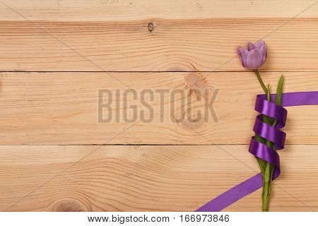 Lilac tulip in the wooden table. Banner template layout mockup for Woman Day, Valentines Day and Teacher's Day. Photo for posts, blogs, advertising and news.