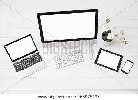 Different sized screens of desktop and laptop computers tablet and phone