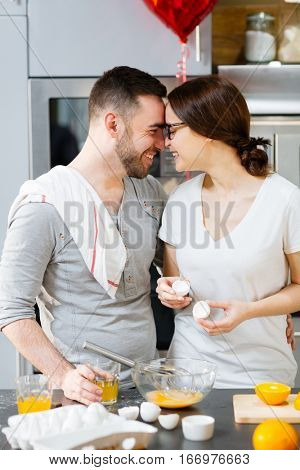 Amorous couple spending morning in the kitchen