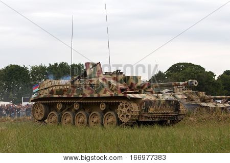 WESTERNHANGER, UK - JULY 24: German armour advances on allied positions during a counterattack in the main battle re-enactment at the War & Peace revival show on July 24, 2015 in Westernhanger
