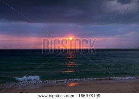 Stormy clouds over dark ocean in Thailand
