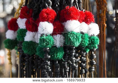 Traditional tricolor leather whips for hungarian shepherds and horsemen. Shallow depth of fields
