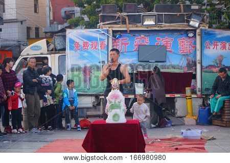 Shenzhen, China -1 27, 2017: the streets of folk performers acrobatics, people in the crowd. In Shenzhen, china.