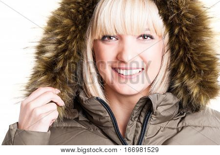 Close-up Of Cute Girl Holding Winter Furry Hood