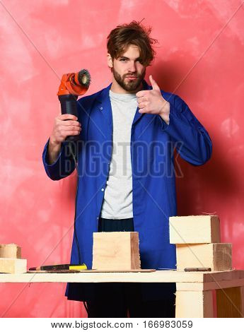 Builder Man Holding Grinder Machine