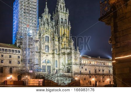 Night view of the Santiago de Compostela Cathedral under repair of its left tower