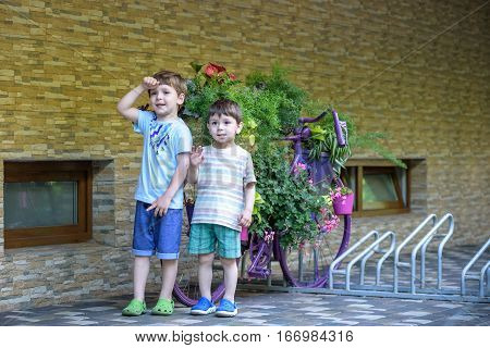 Portrait Of  Young Smiling Boys In Striped Shirt In Park At Evening.
