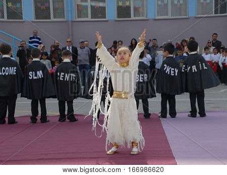 ANKARA, TURKEY - APRIL 23, 2014 : Childs and students performed a show during the April 23 National Sovereignty and Children's Day at Nenehatun Primary School.