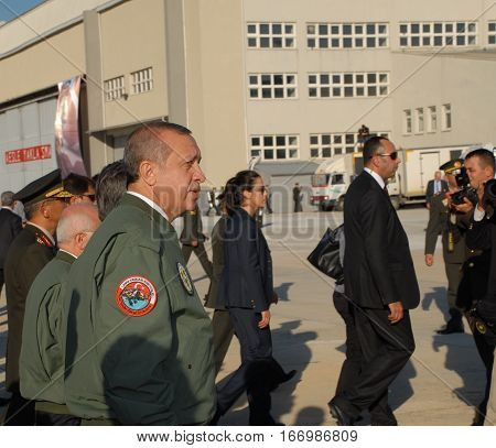 ANKARA, TURKEY - JUNE 10 2014 : Turkish Prime Minister Recep Tayyip Erdogan (in flight jacket) on the apron of Turkish Land Forces Aviation Command