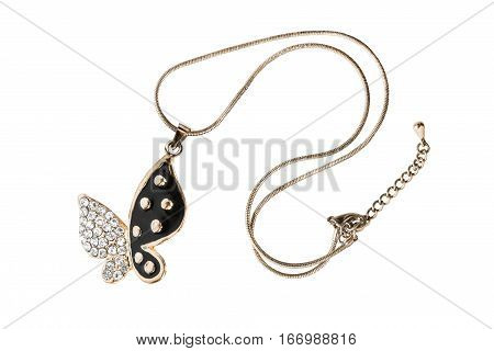 Diamond butterfly pendant on golden chain isolated over white
