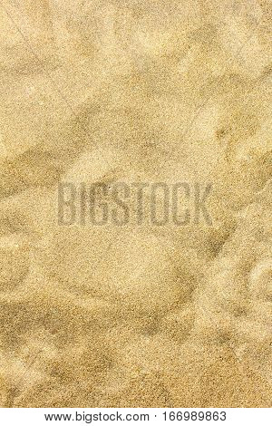Beach sand closeup for background. Tropical beach macro photo. Exotic island sandy beach texture. Soft sand surface backdrop for vacation template holiday card or banner.