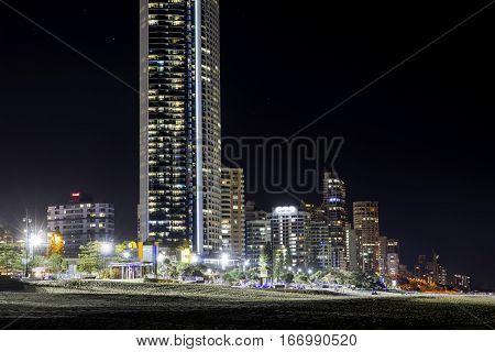 GOLD COAST, AUSTRALIA - JANUARY 24 2017: Close up of Gold Coast Surfers Paradise famous beach and cityscape at night