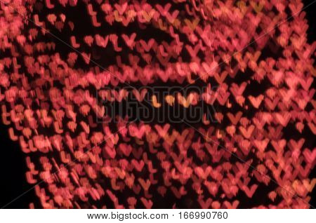 love pink bokeh effect dark black background