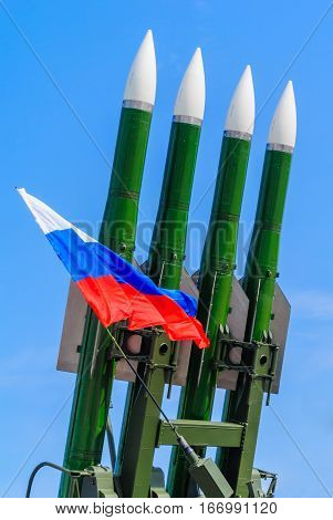 Russian flag on a background of rocket launchers.