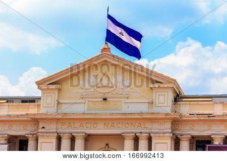 Nicaragua flag on the national Palace. Nicaragua flag on the sky background.