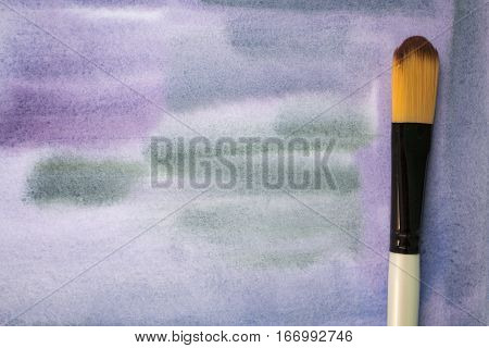 Watercolor background in grey and purple shades. Painted watercolor paper with abstract ornament. Brush and watercolor brush strokes on white. Gloomy watercolor backdrop. Stormy sky watercolour image