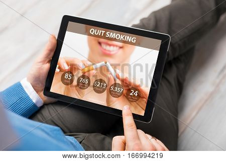 Man using app on tablet  to quit smoking