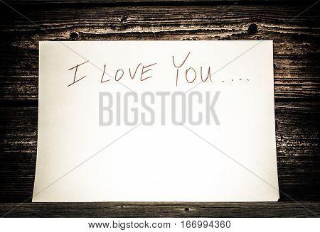 On a white sheet of paper written in Sharpie