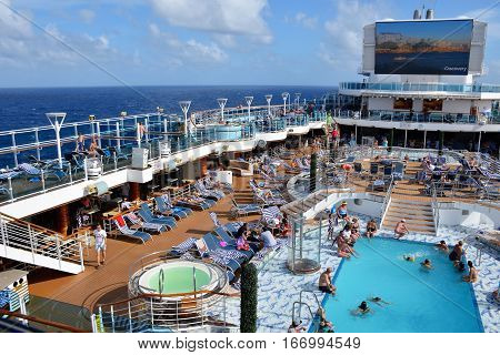 CARIBBEAN SEA - JANUARY, 2017: An overview of the pool deck on a cruise ship with room for text.