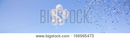 Ballons in the sky with confetti at the party
