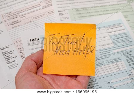 Tax form 1040 with pen calculator and sticker