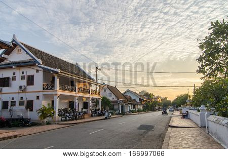 Luang Prabang Laos - 8 December 2016: Sunset over Sakkaline Road one of the main roads running through the heritage zone of Luang Prabang