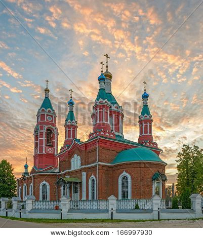 Russian orthodox church with domes over burning sunset